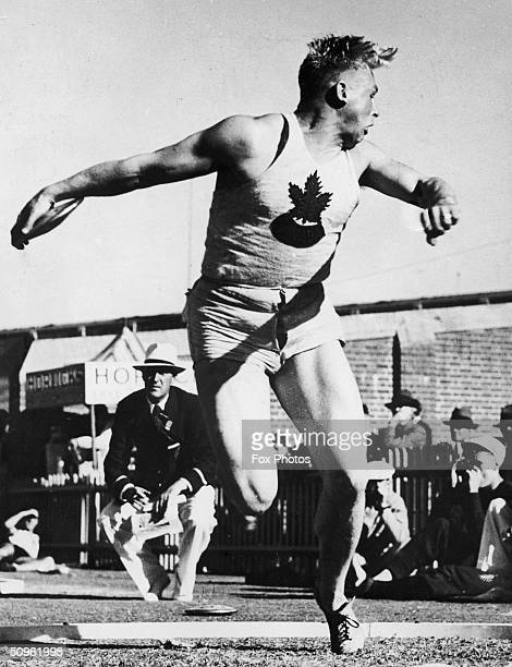 Canadian athlete Eric Coy wins the gold medal in the discus event at the Empire Games in Sydney, 21st February 1938.