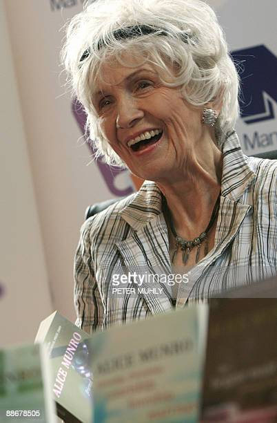 Canadian author Alice Munro holds one of her books as she receives her Man Booker International award at Trinity College Dublin in Dublin Ireland on...