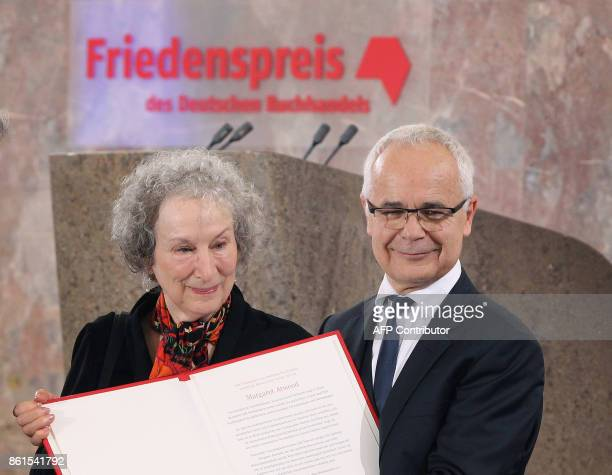 Canadian author Margaret Atwood is awarded the Peace Prize of the German Book Trade by the association's chairman Heinrich Riethmueller in Frankfurt...
