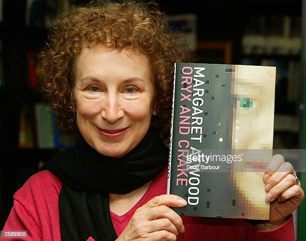 Canadian author Margaret Atwood poses with her book ''Oryx and Crake'' on October 14 2003 in London England Atwood is among the six authors...