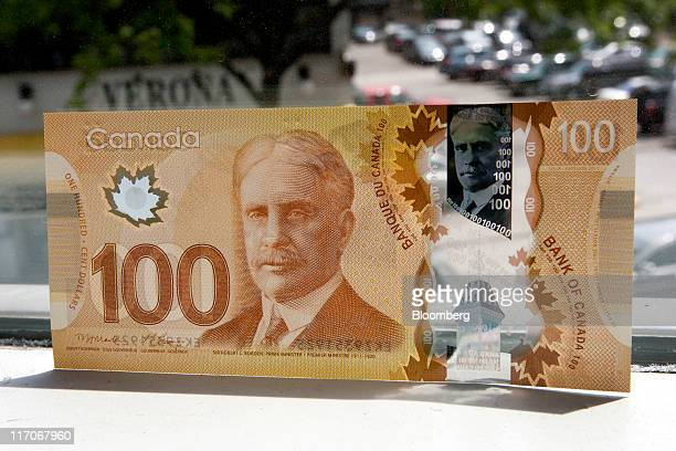 Canadian bank note is arranged for a photograph in Toronto Ontario Canada on Monday June 20 2011 Canada's currency earlier fell to almost the lowest...