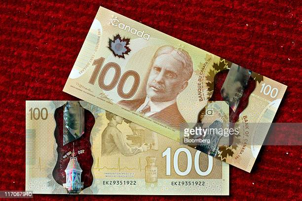 Canadian bank notes are arranged for a photograph in Toronto Ontario Canada on Monday June 20 2011 Canada's currency earlier fell to almost the...