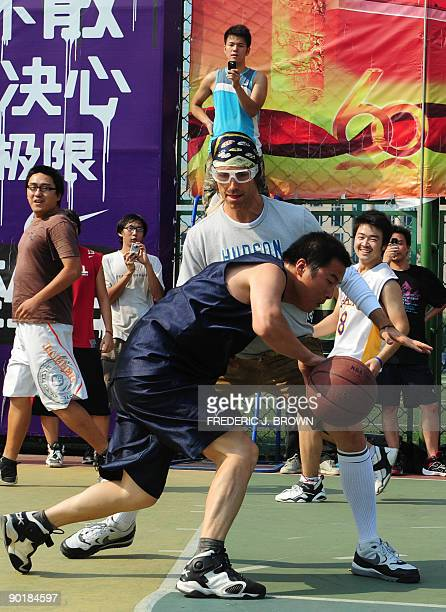 Canadian basketball star Steve Nash plays a pickup game of basketball at the Dongdan courts in central Beijing on August 30, 2009. Nash, a two-time...