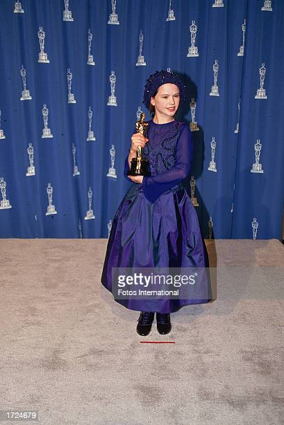 Canadian born actor Anna Paquin holds up the Oscar statuette she won for Best Supporting Actress for her role in the film 'The Piano' Academy Awards...