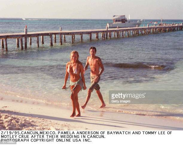 Canadian born actor Pamela Anderson and Greek born musicican Tommy Lee on the beach following their wedding Cancun Mexico February 1995