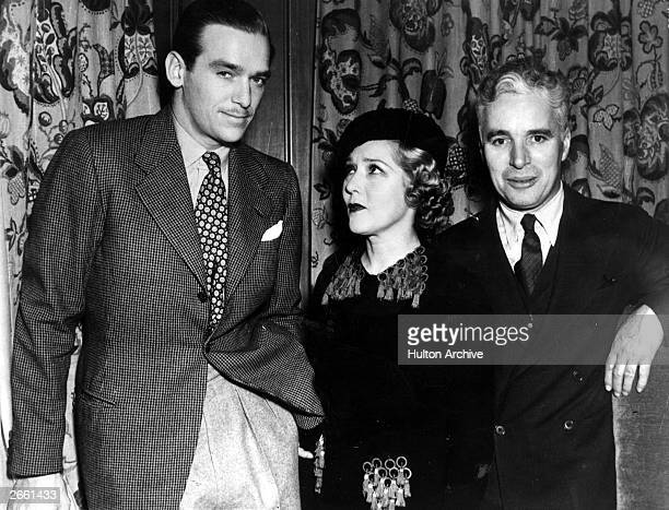 Canadian born American actress Mary Pickford with her step son Douglas Fairbanks Junior , and Charlie Chaplin at a conference of United Artists,...