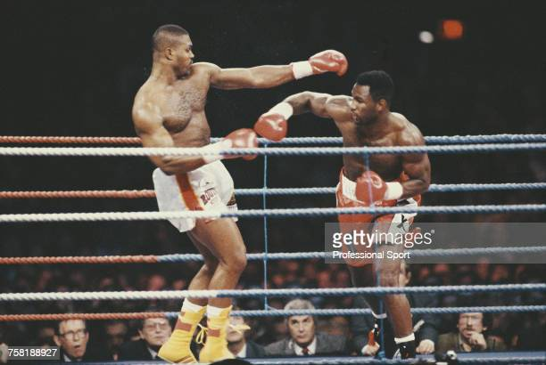 Canadian born British boxer Lennox Lewis pictured in action to defeat Canadian boxer Donovan Ruddock to retain the Commonwealth heavyweight title at...