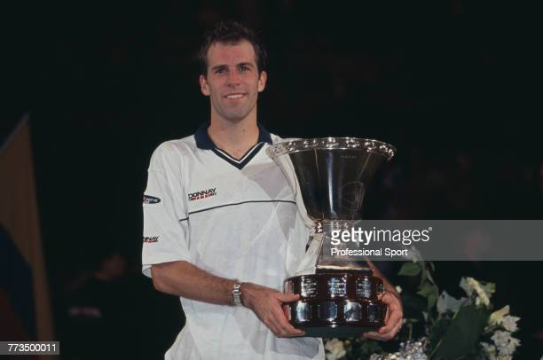 Canadian born British tennis player Greg Rusedski pictured holding the trophy after beating Tommy Haas of Germany 63 64 67 76 to win the final of the...
