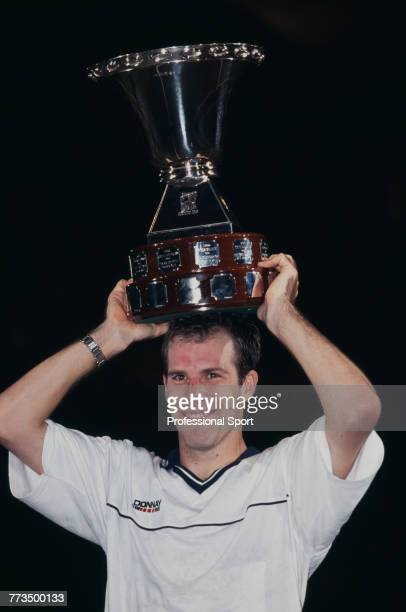 Canadian born British tennis player Greg Rusedski pictured holding the trophy above his head after beating Tommy Haas of Germany 63 64 67 76 to win...