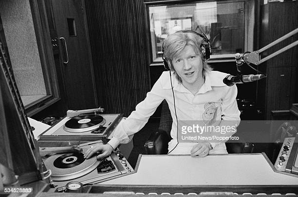 Canadian born DJ David 'Kid' Jensen pictured in a radio broadcast studio at BBC Radio 1 after joining the roster of disc jockeys at the station in...