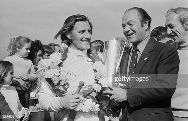 Canadian business tycoon Max Aitken presents the International Trophy to racing driver Graham Hill at Silverstone UK 9th May 1971