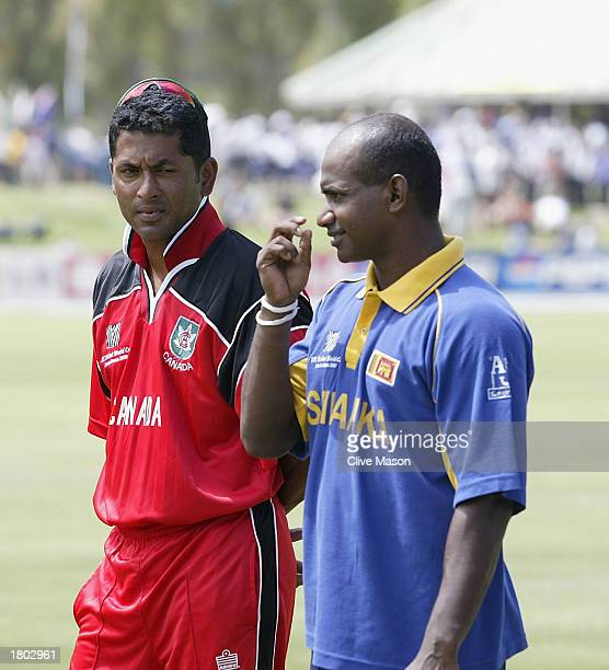 Canadian Captain Joseph Harris lstanding with fellow Sri Lanka captain Sanath Jayasuriya after history is made as Canada are bowled all out for 36...
