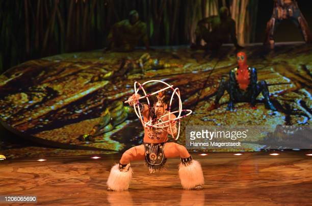 "Canadian circus troop ""Cirque du Soleil"" performs in their acrobatic performance during the premiere of ""Totem"" by Cirque du Soleil at Theresienwiese..."