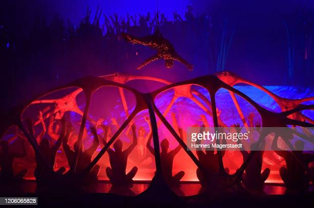 Canadian circus troop Cirque du Soleil performs in their acrobatic performance during the premiere of Totem by Cirque du Soleil at Theresienwiese on...