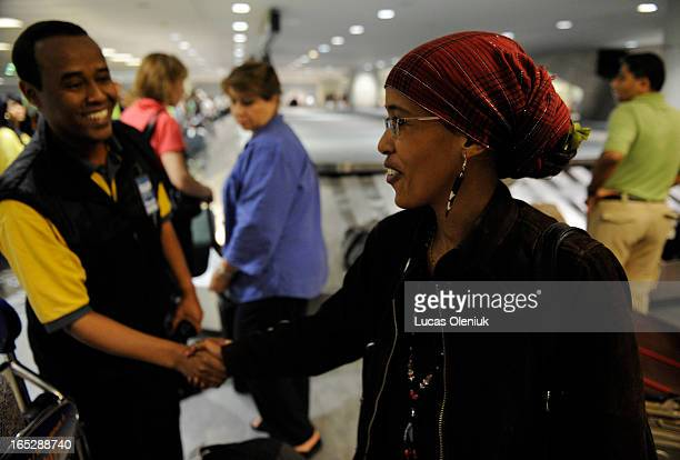 Canadian citizen Suaad Hagi Mohamud is greeted by a Somali porter at Toronto Person Airport just before delivering herself to a mob of family friends...
