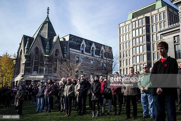 Canadian citizens stands in silence during a Remembrance Day ceremony which marks the anniversary of the official end of the World War I hostilities...