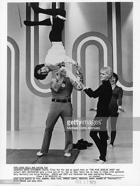 Canadian comedian actor writer director and author David Steinberg guest hosts 'The Mike Douglas Show' with Joey Heatherton and gymnasts Gary...