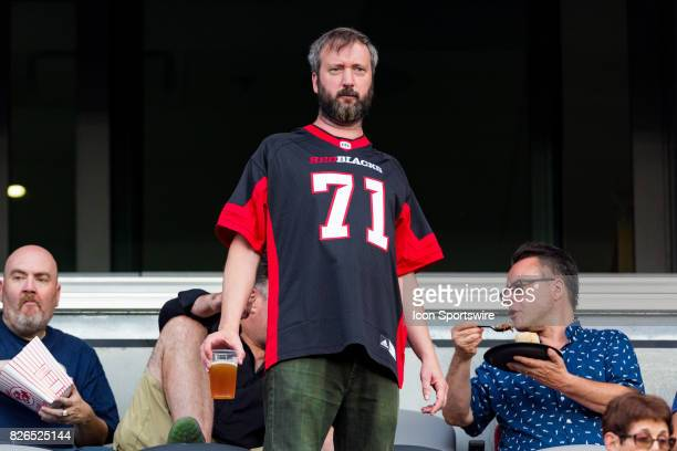 Canadian comedian Tom Green enjoys a beer during Canadian Football League action between Montreal Alouettes and Ottawa RedBlacks on July 19 2017 at...