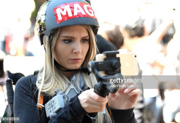 Canadian conservative and libertarian activist Lauren Southern live streams a video during a rally in Berkeley California on April 27 2017...