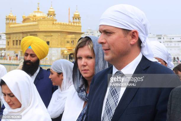 Canadian Conservative leader Andrew Scheer and his wife Jill Scheer pay their respects at the Sikh shrine of Golden Temple in Amritsar on October 10...