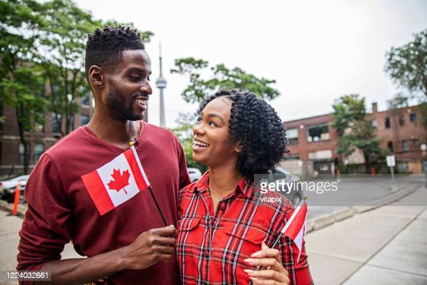 canadian couple celebrating canada day - canada day stock pictures, royalty-free photos & images