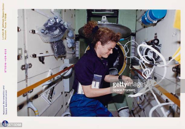 Canadian CSA astronaut Julie Payette works inside the Russian-built Zarya module during the outfitting of the International Space Station , which was...
