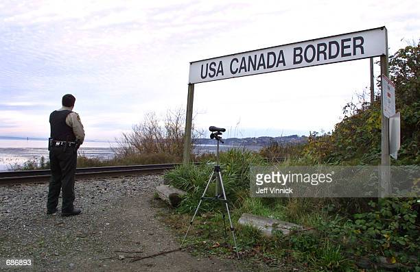 Canadian Customs and Fisheries officer watches over the USCanada border between Blaine Washington and White Rock British Columbia November 8 2001 in...