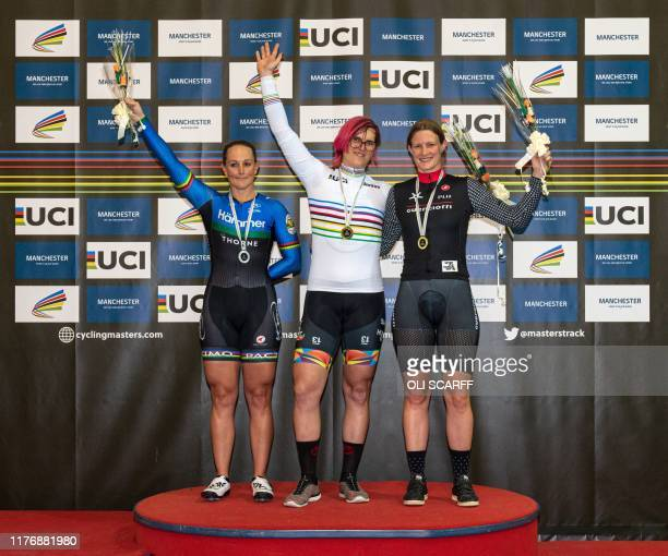 Canadian cyclist Rachel McKinnon celebrates her gold medal on the podium with bronze medalist Kirsten Herup Sovang of Denmark and silver medalist...