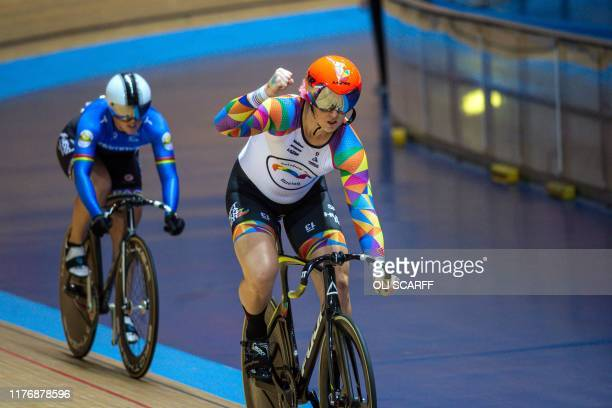Canadian cyclist Rachel McKinnon celebrates victory over USA's Dawn Orwick in the first race of their F3539 Sprint Final during the 2019 UCI Track...