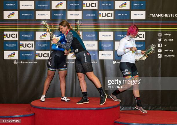 Canadian cyclist Rachel McKinnon leaves the podium after celebrating her gold medal with bronze medalist Kirsten Herup Sovang of Denmark and silver...
