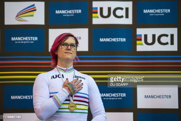 Canadian cyclist Rachel McKinnon listens to the Canadian national anthem as she celebrates her gold medal on the podium for the F3539 Sprint...
