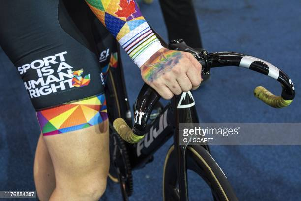 Canadian cyclist Rachel McKinnon prepares her bike before competing in the F3539 Sprint Final during the 2019 UCI Track Cycling World Masters...