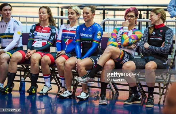 Canadian cyclist Rachel McKinnon waits with fellow athletes including Kirsten Herup Sovang of Denmark and Dawn Orwick of the USA before collecting...