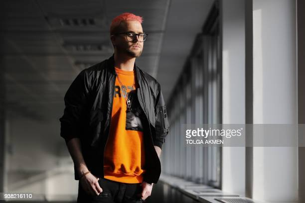 Canadian data analytics expert and whistle-blower, Christopher Wylie poses for photographs outside a press conference in London on March 26, 2018. -...