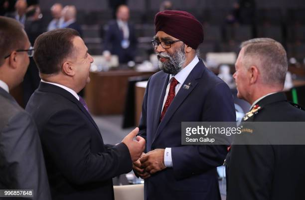 Canadian Defense Minister Harjit Sajjan chats with Ukrainian Defense Minister Stepan Poltorak at a working session of NATO leaders and the...