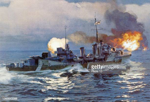 """Canadian destroyer """"Haida"""" firing its 120-mm guns at a German destroyer burning on the horizon, during the battle of the Isle of Batz , April 29,..."""