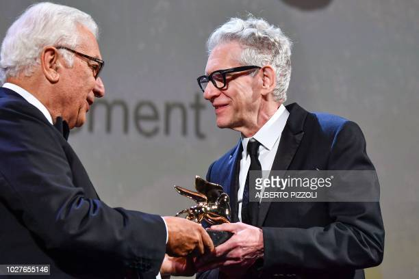 Canadian director David Cronenberg receives a Golden Lion for Lifetime Achievement award from president of the Venice Biennale Paolo Baratta during a...