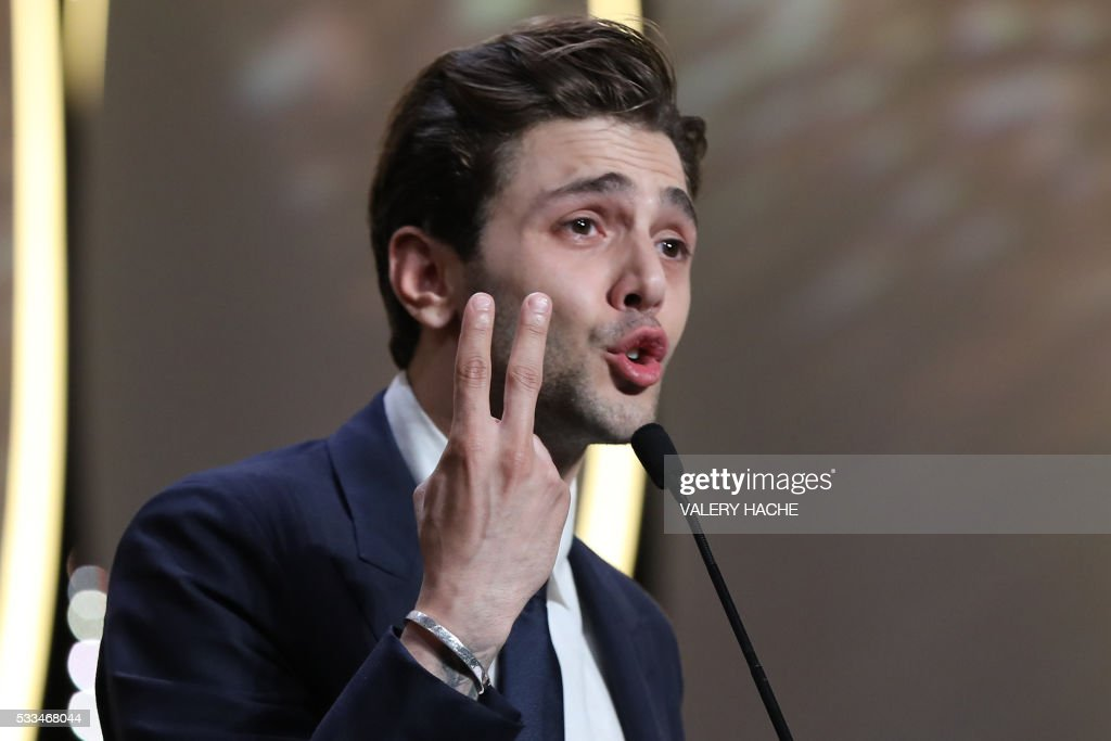 Canadian director Xavier Dolan delivers a speech after being awarded with the Grand Prix for the film 'It's Only The End Of The World (Juste La Fin Du Monde)' during the closing ceremony of the 69th Cannes Film Festival in Cannes, southern France, on May 22, 2016. / AFP PHOTO / Valery HACHE