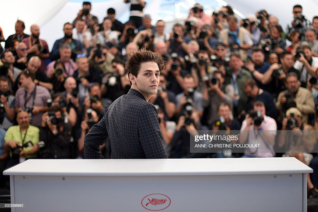 TOPSHOT - Canadian director Xavier Dolan poses on May 19, 2016 during a photocall for the film 'It's Only The End Of The World (Juste La Fin Du Monde)' at the 69th Cannes Film Festival in Cannes, southern France. / AFP / ANNE