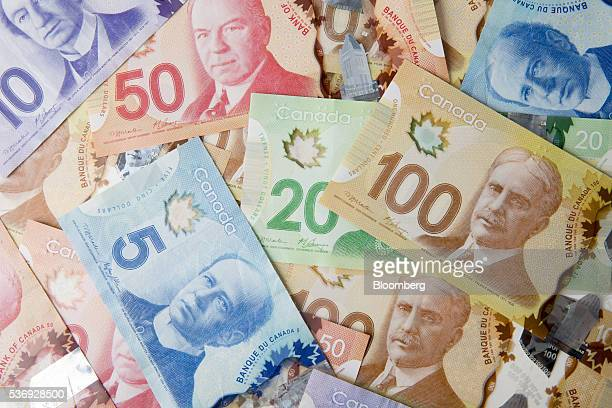 Canadian dollar banknotes are displayed in an arranged photograph in Toronto Canada on Monday May 30 2016 Canada's biggest banks forecast that more...