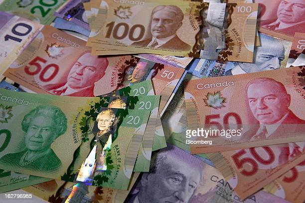 Canadian dollar bills are arranged for a photograph in Toronto Ontario Canada on Tuesday Feb 26 2013 Canada's dollar traded at almost the weakest...