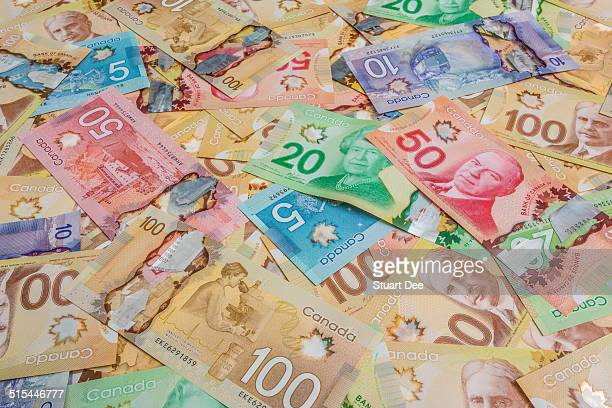 canadian dollar bills - canadian currency stock pictures, royalty-free photos & images