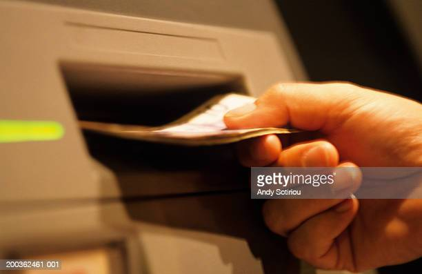 Canadian dollar withdrawal from ATM at night, close-up