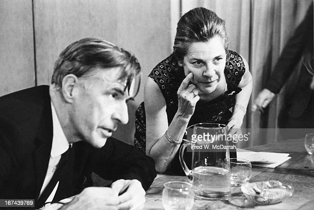 Canadian economist and author John Kenneth Galbraith and American author and critic Mary McCarthy listen to an unseen person during one of the...