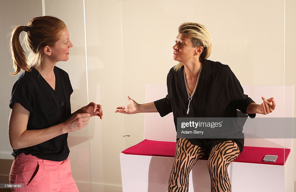 Canadian electronic musician and performance artist Peaches (Merrill Beth Nisker) (R) speaks with visitor Kati Krause in the 'live exhibit' portion of the exhibition 'The Whole Truth - Everything You Always Wanted To Know About Jews...' on its second to last day after a run of over five months at the Juedisches Museum (Jewish Museum Berlin) on August 31, 2013 in Berlin, Germany. The temporary exhibition, which challenges cliches about Jews, featured a different volunteer 'real live Jew' on site for two hours every day to answer visitors' spontaneous questions about their religion. Critics compared the exhibit to 19th-century European freak show attractions under the name Hottentot Venus, but supporters saw the live section as being educational for visitors.