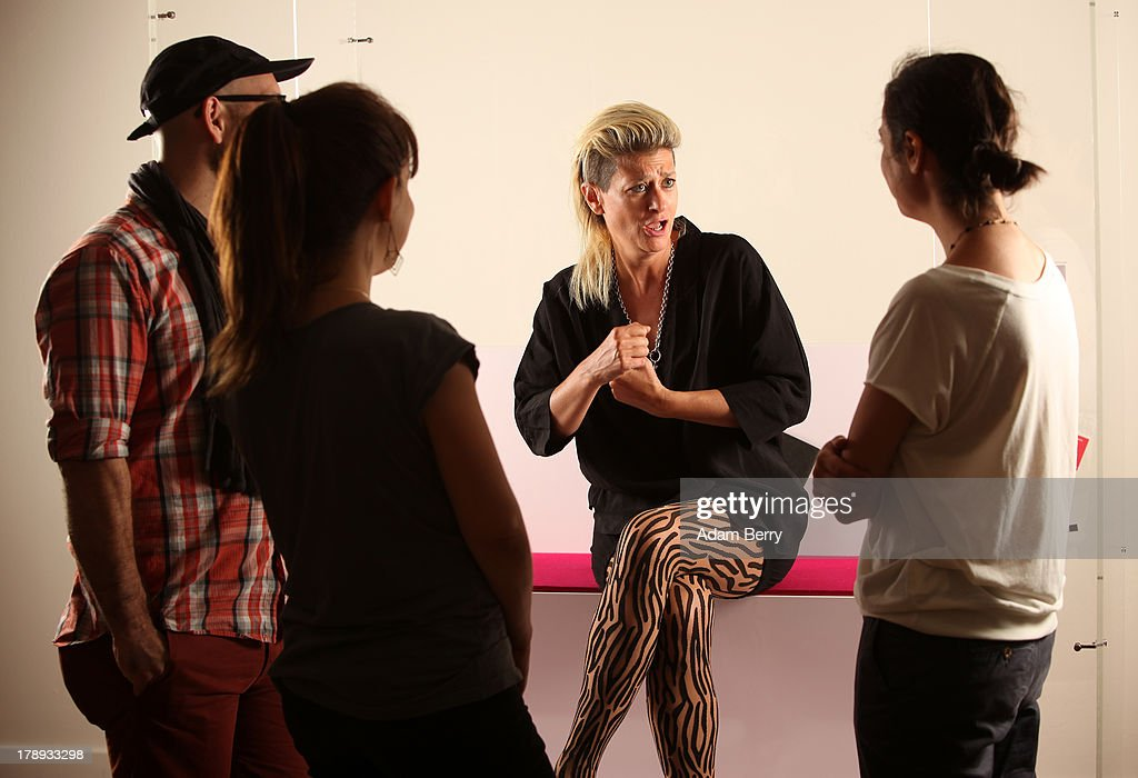 Canadian electronic musician and performance artist Peaches (Merrill Beth Nisker) (C) speaks to visitors in the 'live exhibit' portion of the exhibition 'The Whole Truth - Everything You Always Wanted To Know About Jews...' on its second to last day after a run of over five months at the Juedisches Museum (Jewish Museum Berlin) on August 31, 2013 in Berlin, Germany. The temporary exhibition, which challenges cliches about Jews, featured a different volunteer 'real live Jew' on site for two hours every day to answer visitors' spontaneous questions about their religion. Critics compared the exhibit to 19th-century European freak show attractions under the name Hottentot Venus, but supporters saw the live section as being educational for visitors.