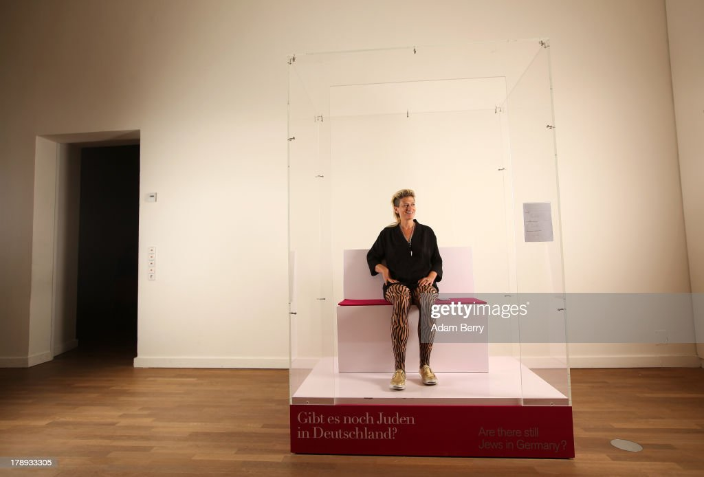 Canadian electronic musician and performance artist Peaches (Merrill Beth Nisker) waits for visitors in the 'live exhibit' portion of the exhibition 'The Whole Truth - Everything You Always Wanted To Know About Jews...' on its second to last day after a run of over five months at the Juedisches Museum (Jewish Museum Berlin) on August 31, 2013 in Berlin, Germany. The temporary exhibition, which challenges cliches about Jews, featured a different volunteer 'real live Jew' on site for two hours every day to answer visitors' spontaneous questions about their religion. Critics compared the exhibit to 19th-century European freak show attractions under the name Hottentot Venus, but supporters saw the live section as being educational for visitors.
