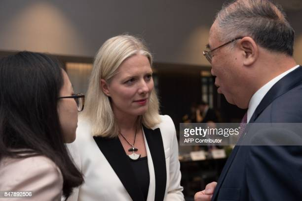 Canadian Environment Minister Catherine McKenna and Chinese Special Representive for Climate Change Affairs Xie Zhenhua chat during the environment...
