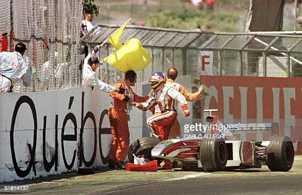 Canadian F1 driver Jacques Villeneuve jumps out of his car after crashing at the Circuit Gilles Villeneuve during the Canadian Grand Prix in Montreal...