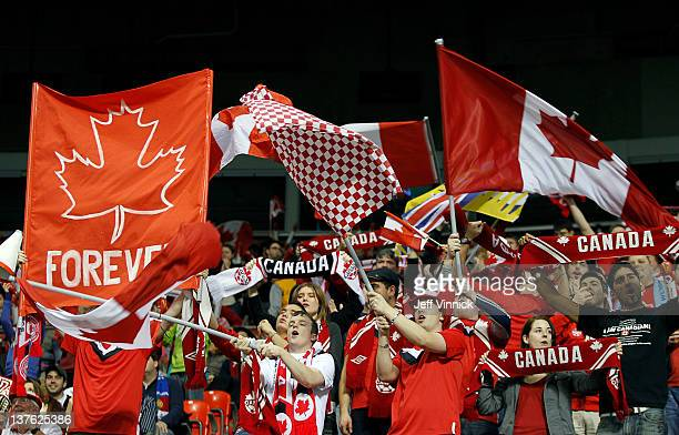 Canadian fans celebrate a goal against Costa Rica during the 2012 CONCACAF Women's Olympic Qualifying Tournament at BC Place on January 23 2012 in...